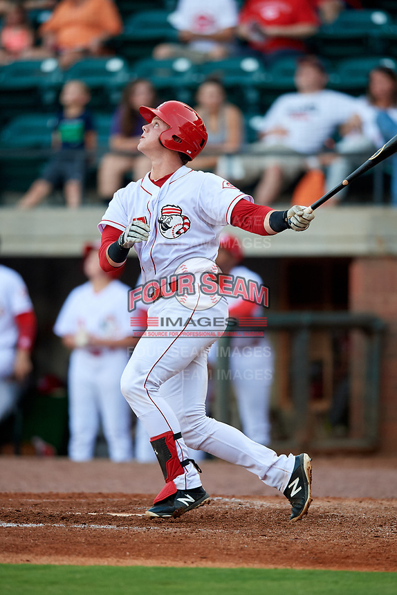 Greeneville Reds catcher Robert Boselli (47) follows through on a swing during a game against the Pulaski Yankees on July 27, 2018 at Pioneer Park in Tusculum, Tennessee.  Greeneville defeated Pulaski 3-2.  (Mike Janes/Four Seam Images)