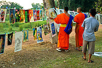 Prints on Display Along Vientiane Riverbank - Much of the activity in Vientiane has always centred along the Mekong riverside.  Most evenings, people gather to play badmitten, stroll the riverbank, have a sundowner or even buy and sell printed artwork.