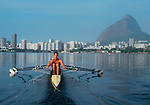 Rowing, Rio de Janeiro, Brazil, South America, Elite rowers from the Vasco de Gamma Rowing Club row on the Lagoa toward the highrises of Ipanema, .