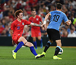 Josh Sargent (left) of the United States grabs at Sebastian Coates of Uruguay during an international friendly game  on September 10, 2019 at Busch Stadium in St. Louis, Missouri USA<br /> AFP Photo by Tim VIZER