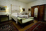 Bedroom of regency country house Cavendish Hall, in Cavendish, Suffolk, United Kingdom. Cavendish Hall is a building belonging to the Landmark Trust, a United Kingdom building preservation charity that rescues historic buildings at risk and gives them a new life as places to stay in and experience.