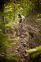 A mountain biker rides The Flow trail of Copper Harbor Michigan.