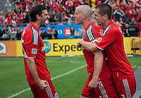 22 May 2010: Toronto FC midfielder Martin Saric #25 and Toronto FC midfielder Sam Cronin #2 celebrate a goal by Toronto FC forward Chad Barrett #19 in the second half during a game between the New England Revolution and Toronto FC at BMO Field in Toronto..Toronto FC won 1-0.....