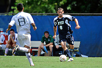 10 September 2011:  FIU's Nicholas Chase (8) moves the ball upfield in the second half as the FIU Golden Panthers defeated the Stetson University Hatters, 3-2 in the second overtime period, at University Park Stadium in Miami, Florida.