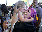 Graduate Audrey Clark, of Gardnerville, celebrates with her daughter Ayden, 5, following the Western Nevada College 2017 Commencement in Carson City, Nev. on Monday, May 22, 2017.  <br />