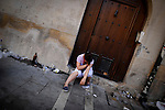 Woman sleep before Chupimazo of the San Fermin Festival, on July 06, 2012, in Pamplona, northern Spain. The festival is a symbol of Spanish culture that attracts thousands of tourists to watch the bull runs despite heavy condemnation from animal rights groups. (c) Pedro ARMESTRE