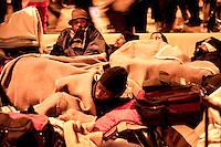 Profughi di guerra e richiedenti asilo politico sudanesi, eritrei e somali, dopo lo sgombero dello stabile occupato in via Lecco. Milano, 27 dicembre, 2005<br /> <br /> Sudanese, Somali and Eritrean war refugees and asylum seekers after the eviction of a disused building. Milan, December 22, 2005