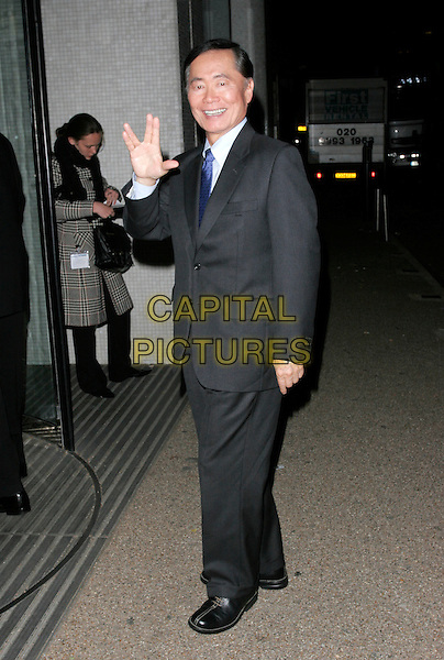 "GEORGE TAKEI.""An Audience With Celine Dion"" TV recording, LWT Studios, London, England. .October 30th 2007.full length grey gray suit hand palm gesture star trek.CAP/AH.©Adam Houghton/Capital Pictures."