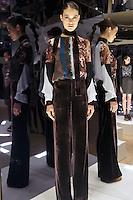Model in Look 23: Torn Wallpaper Top, Chocolate Velvet Pant