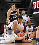 SIOUX FALLS, SD - MARCH 6: Mikaela Shaw #22 of Omaha and Jenna Gunn #32 and Mikale Rogers #33 of IUPUI battle for the ball in the 2016 Summit League Tournament. (Photo by Dick Carlson/Inertia)