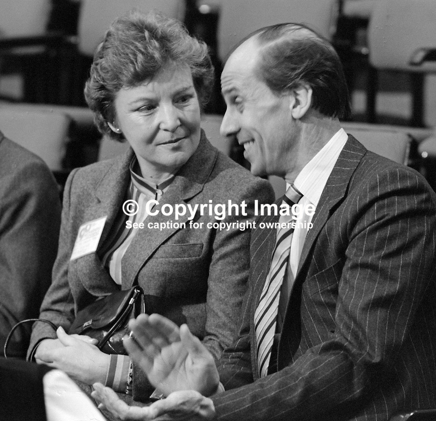 Secretary of State for Employment, Norman Tebbit, with his wife, Margaret Tebbit, in the audience at the annual conference, Conservative Party, held in Brighton, October 1982. It was two years later that Mr and Mrs Tebbit were to be seriously injured in the Provisional IRA bombing of the Grand Hotel adjacent to the Brighton Centre, the conference venue. 198210142NT3<br />