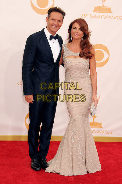 Mark Burnett, Roma Downey<br /> The 65th Annual Primetime Emmy Awards - Arrivals held at The Nokia Theatre L.A. Live in Los Angeles, California, USA.<br /> September 22nd, 2013 <br /> full length grey gray married husband wife dress black tuxedo   <br /> CAP/ADM/BP<br /> &copy;Byron Purvis/AdMedia/Capital Pictures