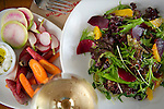A feta snack (left) and a salad of farm lettuces, fresh oranges, roasted beets in a shallot vinaigrette, photographed at Miller Union for Choice Tables on Wednesday, April 20, 2011 in Atlanta.  (Rich Addicks/Photographer) 10110950A