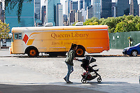 A mobile branch of the Queens Library is parked in Long Island City in New York on Saturday, September 26, 2015. (© Richard B. Levine)