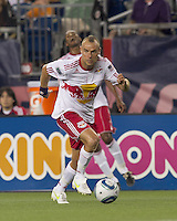 New York Red Bulls midfielder Joel Lindpere (20) on the attack. In a Major League Soccer (MLS) match, the New England Revolution tied New York Red Bulls, 2-2, at Gillette Stadium on August 20, 2011.