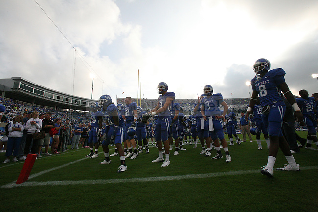The UK football team walks on the field of Commonwealth Stadium before the game against the University of Florida. Photo by Adam Wolffbrandt | Staff