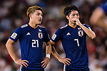 Doan Ritsu of Japan (L) and Shibasaki Gaku of Japan (R) talk during the AFC Asian Cup UAE 2019 Semi Finals match between I.R. Iran (IRN) and Japan (JPN) at Hazza Bin Zayed Stadium  on 28 January 2019 in Al Alin, United Arab Emirates. Photo by Marcio Rodrigo Machado / Power Sport Images