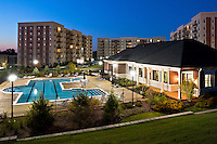 A luxurious appartment community with splendid amenities such as swimming pool in Downers Grove, Illinois at dusk.