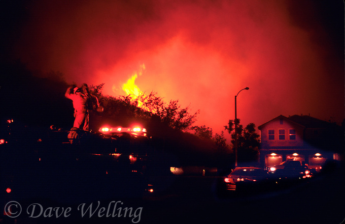 870000310 fire crews battle the as yet uncontrolled topanga wildfire raging through the hillsides above a community of private homes in the agoura hills in southern california