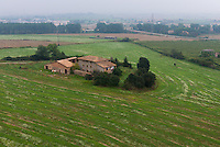 Small farm house among fields from air baloon near Vic, Spain