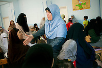 Dr Omaima Kamel, a 51-year-old Muslim Sister, greets women of Al Saf village assembled at the school to attend her speech. Egypt, June 13th, 2012.