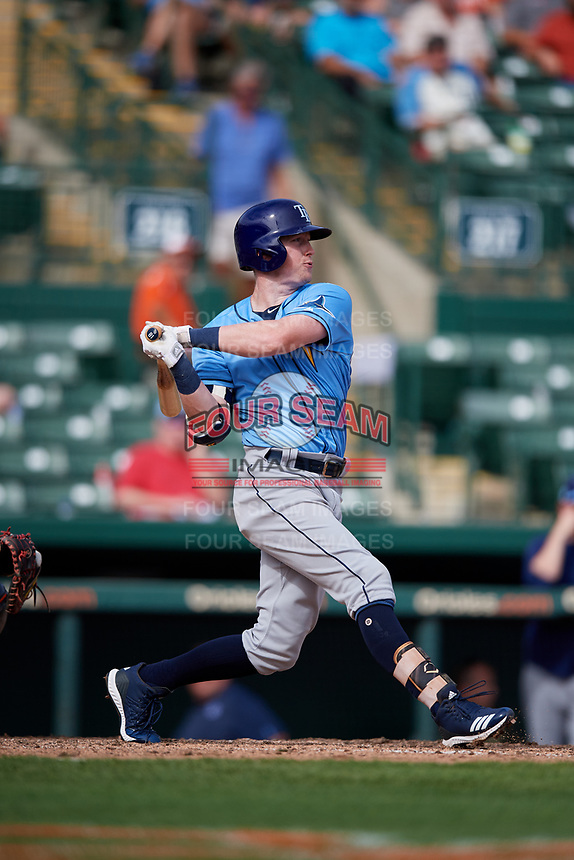 Tampa Bay Rays shortstop Jake Cronenworth (81) follows through on a swing during a Grapefruit League Spring Training game against the Baltimore Orioles on March 1, 2019 at Ed Smith Stadium in Sarasota, Florida.  Rays defeated the Orioles 10-5.  (Mike Janes/Four Seam Images)