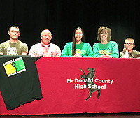 Courtesy Photo McDonald County High School cheerleader Bailey Barrett (center) recently signed to cheer next year at Missouri Southern State University. Shown above is (left) Blake Barrett (brother), Brandon Barrett (dad), Bailey Barrett, Mandy Barrett (mom) and Bryer Barrett (brother).