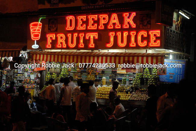 Fruit juice stand in the Paharganj district of New Delhi, India.