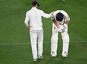 25th March 2018, Auckland, New Zealand;  New Zealand captain Kane Williamson consoles captain Joe Root after Root injured his finger.<br /> New Zealand versus England. 1st day-night test match. Eden Park, Auckland, New Zealand. Day 4