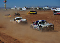 Apr 17, 2011; Surprise, AZ USA; LOORRS driver Travis Coyne (5) leads Carl Renezeder (17) during round 4 at Speedworld Off Road Park. Mandatory Credit: Mark J. Rebilas-