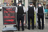 Police officers and advertisment for a tattoo parlour, Camden Town.