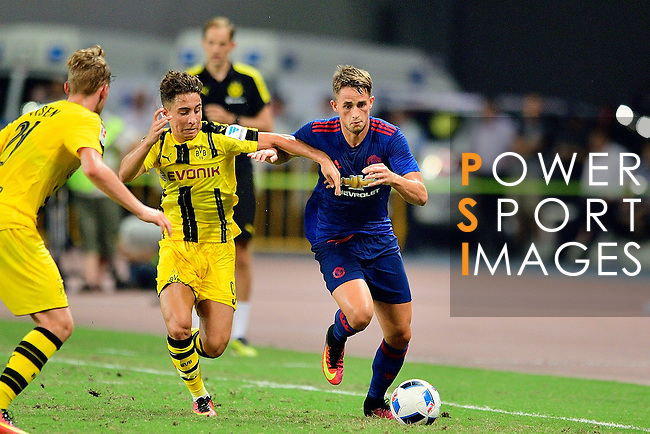 Manchester United winger Adnan Januzaj (r) fights for the ball with Borussia Dortmund midfielder Emre Mor (l) during the International Champions Cup China 2016, match between Manchester United vs Borussia  Dortmund on 22 July 2016 held at the Shanghai Stadium in Shanghai, China. Photo by Marcio Machado / Power Sport Images