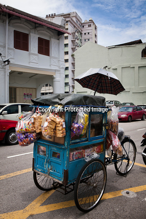 A rare sight of a cycle rickshaw selling bakery items in capital Georgetown of Penang, Malaysia. Photo: Sanjit Das/Panos