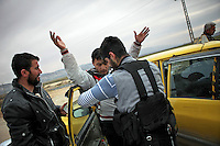 SYRIA, 02.2012, Idlib province. © Timo Vogt/EST&OST. Members of the Free Syrian Army search a taxi driver before he can pass.