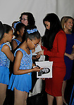Michelle Kwan signs for fans at Skating with the Stars - a benefit gala for Figure Skating in Harlem in its 17th year is celebrated with many US, World and Olympic Skaters honoring Michelle Kwan and Jeff Tweedy on April 7, 2014 at Trump Rink, Central Park, New York City, New York. (Photo by Sue Coflin/Max Photos)