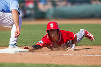 North Carolina State first baseman Tarran Senay (32) reaches for first base on a pick off attempt during Game 3 of the 2013 Men's College World Series between the North Carolina State Wolfpack and North Carolina Tar Heels at TD Ameritrade Park on June 16, 2013 in Omaha, Nebraska. The Wolfpack defeated the Tar Heels 8-1. (Andrew Woolley/Four Seam Images)