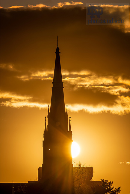March 29, 2020; Sunrise behind the Basilica of the Sacred Heart steeple (Photo by Matt Cashore/University of Notre Dame)