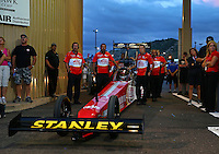 Jul. 19, 2013; Morrison, CO, USA: Crew members with NHRA top fuel dragster driver Doug Kalitta during qualifying for the Mile High Nationals at Bandimere Speedway. Mandatory Credit: Mark J. Rebilas-
