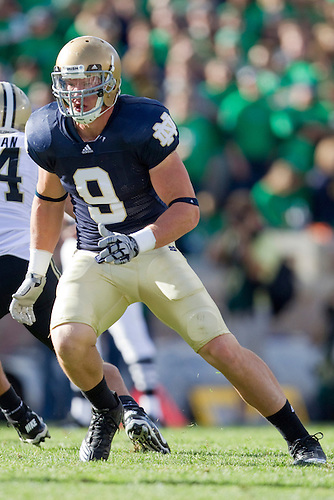 Notre Dame tight end Kyle Rudolph (#9) running route in game action during NCAA football game between the Notre Dame Fighting Irish and the Purdue Boilermakers.  Notre Dame defeated Purdue 23-12 in game at Notre Dame Stadium in South Bend, Indiana.