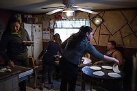 Esperanza Moctezuma prepares dinner for her family in Painesville, Ohio. March 25, 2014. Photo by Brendan Bannon.