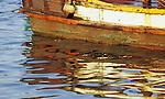Kampot Boat 02 - Traditional Cham fishing boat reflected in the Sanke river, Kampot, Cambodia
