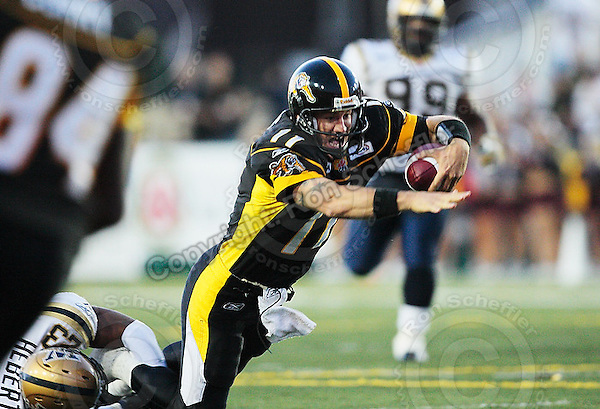 Aug 3, 2007; Hamilton, ON, CAN; Hamilton Tiger-Cats quarterback (11) Jason Maas dives for extra yards as he is tackled by Winnipeg Blue Bombers safety (23) Kyries Hebert during the first half at Ivor Wynne Stadium. Mandatory Credit: Ron Scheffler