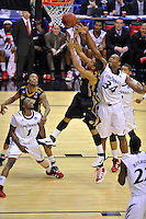 Players from both sides fight for the rebound. Cincinnati defeated Missouri 78-63 during the NCAA tournament at the Verizon Center in Washington, D.C. on Thursday, March 17, 2011. Alan P. Santos/DC Sports Box