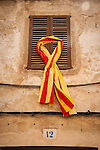 Mallorcan ribbon on a window shutter, narrow streets of Arta, Mallorca