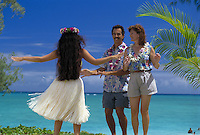 A couple on vacation learn to dance hula at world famous Lanikai beach on Oahu's windward side.