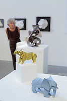 Surface to Structure origami exhibition at Cooper Union, New York. Gallery view. Elephant designed and folded by Tetsuya Gotani 2013 (front). Takin designed and folded by Jake Schenthal 2014 (back).