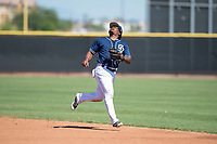 San Diego Padres second baseman Eguy Rosario (97) pursues a pop fly during an Instructional League game against the Milwaukee Brewers at Peoria Sports Complex on September 21, 2018 in Peoria, Arizona. (Zachary Lucy/Four Seam Images)