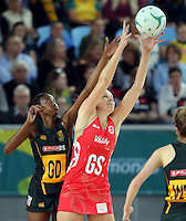 04.09.2016 England's Joanne Harten and South Africa's Zanele Vimbela in action during the Netball Quad Series match between England and South Africa played at Margaret Court Arena in Melbourne. Mandatory Photo Credit ©Michael Bradley.