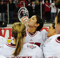 Badger senior, Kelly Nash, kisses the WCHA first place trophy, after the University of Wisconsin women's hockey team tops North Dakota 8-4 on Sunday, 2/13/11, at the Kohl Center in Madison, Wisconsin