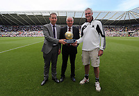 Pictured: Groundsman Dan Duffy (R) with his Premier League Award for the Liberty Stadium pitch, chairman Huw Jenkins (L). Sunday 04 May 2013<br />